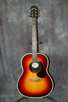 Today, Lawman Guitars is Presenting...  A really nice USA Made 1976 Applause by Ovation Acoustic Guitar. It sounds great, Made in the USA, and comes with the shown original Gigbag Case that fits it great. Give us a call. Lawman Guitars. 515-864-6136