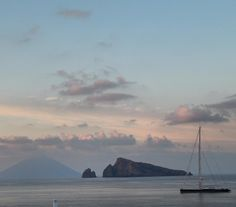 View from Panarea of Stromboli with Isola Lisca Bianca in the foreground. To put size perspective into the scene... The yacht is over 61m in length! panarea #isoleeolie  #italy #Italia #estate #summer2015 #yacht #superyacht #charter by michael_whiley