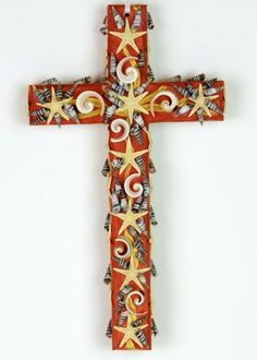 Wood Cross decorated with seashell mosaic and sea stars.