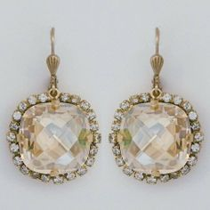 """Parisian Glam Earrings by Catherine Popesco La vie Parisienne. $79.00. lever-back clasp. border of shade crystals. Design is approx. 3/4"""" and hangs at 1 1/4"""". 14kt gold plated. Large pillow cut champagne crystal"""