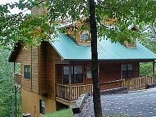 Pigeon Forge, TN: Gatlinburg chalet and cabin rentals: Dances With Wolves 973 is a 2 bedroom 2 bath (the upstairs bathroom has shower only) log cabin located between Ga...