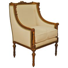 French Louis XVI Style Carved Gitwood, and Painted Bergere, 19th century | From a unique collection of antique and modern bergere chairs at https://www.1stdibs.com/furniture/seating/bergere-chairs/