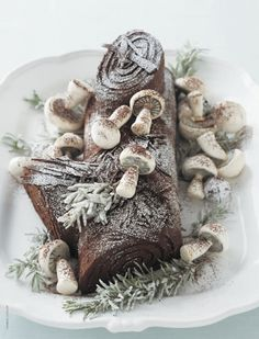 Roll a yule log cake and add wild decor (like the mushrooms, or even real pinecones) for an extra effect. (marthastewart.com)