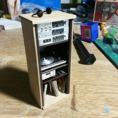 I made an oak surround for the stereo. Just the speakers to put together now. #dollhouseminiatures #dollshouseminiature #dollhousetherapy #modernminiatures #moderndollhouse #miniaturist #dollfurniture #justdollfurniture #minifurniture #oneinchscale #onetwelthscale #dailymini #tinythings #dollhouse