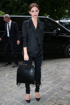 Emma Watson Style: At the Giambattista Valli show during Paris Fashion Week on July 7, 2014 in France.