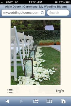 Wedding aisle decor possibility with white lanterns, flame less candles, and Tiffany blue and white petals.