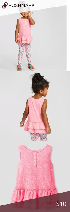 New CAT & JACK Perfect for summer playdates, this Tunic looks great with a colorful pair of leggings. This tunic tank top is made from comfy, breathable jersey-knit cotton rayon for extra softness.   size 4T condition: new without tags color: bali pink  • Cotton, polyester, and rayon construction is soft and lightweight  • Ruffled skirt adds girly flair  • Sleeveless design keeps her cool  • Front button-down closure makes it easy to slip on and off   @cjrose25 Cat & Jack Shirts & Tops…