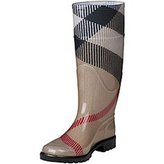 @Overstock - These fashionable rubber rain boots from Burberry feature a exploded check pattern on a classic beige background. Mid-calf height, a 1-inch heel and soft fabric lining will keep your feet warm, dry and stylish.http://www.overstock.com/Clothing-Shoes/Burberry-3464688-Exploded-Check-Rubber-Rain-Boots/6504961/product.html?CID=214117 $199.99
