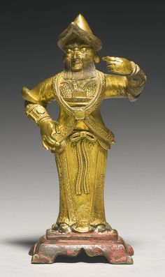 A SMALL GILT-BRONZE FIGURE OF ZHOU CANG, MING DYNASTY. Sotheby's