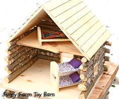 Dream up your greatest, sweetest, most perfect, natural cabin dollhouse design, and see if we can build it for you! Prices start at $100 for a 12 x 12 cabin, with loft, porch, windows, and ladder. (Note: bunk beds not included for this price.)    Real wood will be left in its soft natural unfinished beauty, so your childrens little hands will be touching something real, just cut fresh out of the forest, instead of a piece of plastic pumped out of a china factory somewhere. Once you touch…