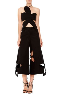 Never one to shy away from drama, the New York designer infuses both day and eveningwear with high impact volume and cut. These **Rosie Assoulin** pants exude a bold, artistic sense of sophistication in a wide legged silhouette replete with expanded floral cutouts.