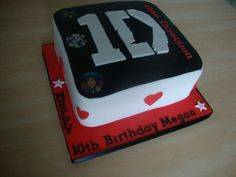 """one direction cake!! yeah and i totally think im a bigger directioner than this 10 year old. i think it should say """"Happy 15th Birthday Emma"""" hahaha"""