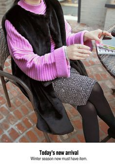 Miamasvin Long Synthetic Fur VestAdd another layer of warmth to your look with this long synthetic fur vest. Designed for easy pairing with a mint pullover, gray slacks, and black high leg boots.- Round neck- Relaxed fit- Vertical welt pockets- Full lining- Snap button closure- Colors: Black, Pink Beige, Blue Gray