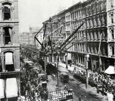 Construction of the elevated tracks over Lake Street in Chicago, Illinois. Looking west from Wabash Avenue. 1896.