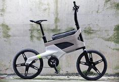 Dit is de DL122 fiets van Peugeot, een concept voor een nieuw soort stadsfiets. Het aluminium/houten frame biedt ruimte aan een laptop en is voorzien van ingebouwd slot. Voorlopig nog een pure vingeroefening maar van ons mag ie zo in productie.
