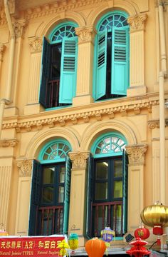 Love the transom windows over the shutters.  And the color.