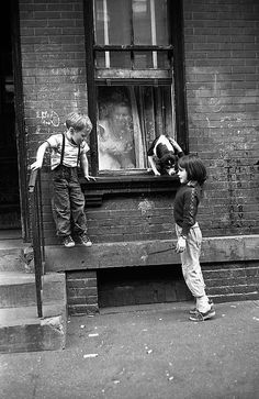 Willie, playing with a neighbor's dog in Hell's Kitchen - by Ken Heyman (1930), USA
