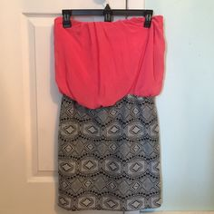 Tribal Print Dress With Solid Top This pretty dress has only been worn once. It doesn't fit anymore, so I have to let it go. It's comfortable and stays up well. The skirt portion is body con, while the top is chiffon and more flowy. Charlotte Russe Dresses Strapless