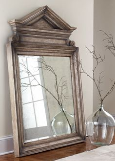 I love the architectual accents on this mirror. The pediment on the top reminds me of traditional colonial homes but it still has some modern flare