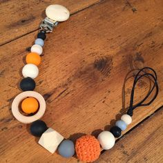 Sensory Teething Pacifier/Toy Clip, Holder, On-Trend, Natural Wood, Silicone and Crochet Beads, Black,Orange and Grey by AeviternalSensory on Etsy