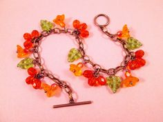 Flower Charm Bracelet Tropical Bouquet and Berries by justCHARMING, $26.00 https://www.etsy.com/listing/36900393/flower-charm-bracelet-tropical-bouquet