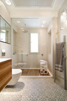 Bathroom with a stunning walk in shower and patterned encaustic tile floor, designed by Alla Tzecher, via @sarahsarna.