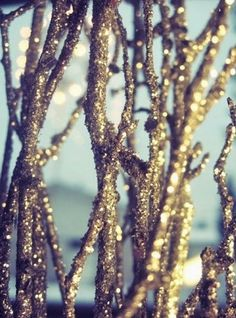 Glittered branches to place in a large vase, maybe hang some crystal ornaments...