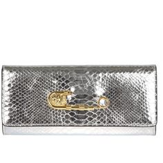 Silver leather reptile textured Versus clutch bag featuring iconic Versace Lion Head gold safety pin. Magnetic snap closure and internal zip pocket are all add…