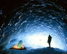 List of gorgeous ice caves to visit . Man with tent in ice cave, Appa glacier, Pemberton Ice Field, British Columbia, Canada (© David Nunuk/Getty Image Oh The Places You'll Go, Places To Travel, Places To Visit, Parc National, National Parks, Destinations, Photo Images, Belle Villa, Canada Travel
