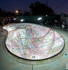 Spray painting a with skateboards... When I get a pool I am getting these guys to paint it for me!!