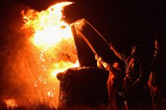 Men from the Clavie Crew carry a burning barrel on the top of a pole packed with tar soaked sticks on January 11, 2016, in Burghead, Scotland. The burning of the Clavie takes place on January 11 each year as local people welcome in the New Year with a fire ceremony which has ancient roots dating back to before 1750, and is believed to bring good luck for the coming year