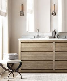 love the modern design with this raw feeling wood + oversized mirrors + cool stool