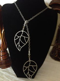 Sterling silver plated Lariet necklace with crystals & leaves!