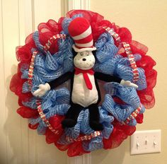 Hey, I found this really awesome Etsy listing at https://www.etsy.com/listing/165031679/cat-in-the-hat-deco-mesh-wreath