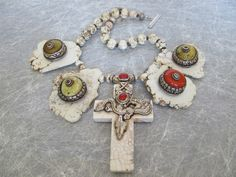 Great antique Tibetan decorative pieces  on slabs with cross centerpiece, by Sallybass.com