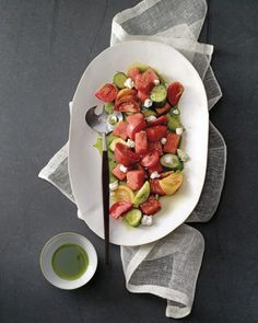 Watermelon works particularly well in savory applications. Here, it plays nice in a summer salad of tomatoes, cucumbers, and goat cheese.