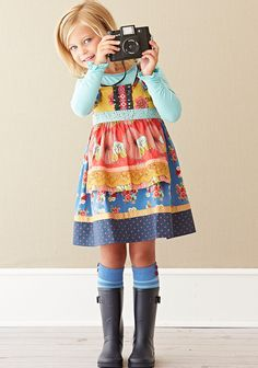Barn Party Knot Dress  Brighten up your day with a happy combo of yellow, blue and red florals. The Barn Party Knot Dress mixes floral-print fabrics with special accents of yellow crochet and polka dot ribbon. Item #: D1686 $56.00