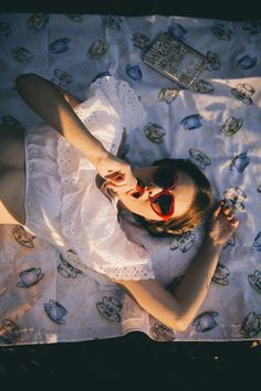 Lolita movie remake with lolita on tea set pattern bedsheet in red heart shaped sunglasses