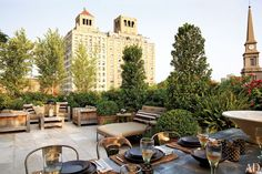 Ralph Lauren chief retail creative officer Alfredo Paredes and writer Brad Goldfarb divided the expansive terrace of their Manhattan apartment into several entertaining areas, including one with a cluster of teak furnishings and another with a zinc dining table surrounded by vintage chairs. (April 2012)