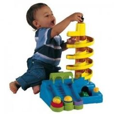 Super Spiral Play Tower by International Playthings is a fabulous one year old toy for your toddler. It teaches cause and effect from the sounds and motions of the tower. It's a great one year old gift. Toddler Gifts, Toddler Toys, Baby Toys, Kids Toys, Phil And Teds Lobster, Learning Express, Baby Learning Toys, Toys For Tots, 1st Birthday Gifts