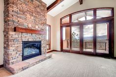 Stone surround fireplace Faux wood beams on ceiling
