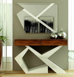 MODERN CONSOLE TABLES | The harmony between this console table and the venetian mirror provides an unique atmosphere to your room | http://modernconsoletables.net/
