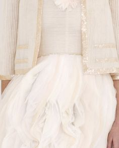 soft white details. And that top. With the hints of beige glitter is amazing!