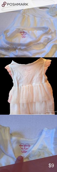 Cream colored, soft tulle Ruffles, TOO CUTE! Cotton dress with Three tier soft tulle Ruffles, soft tulle ruffle along arm, soft tulle flower on front, matching bloomers. Wore once to a wedding, she wasn't crawling or walking so it is really in perfect condition! No stains, piling or tears! Children's Place Dresses