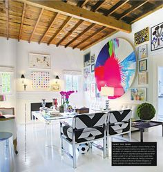 Love this studio! That acrylic desk is to die for... and those chairs... and that huge circle piece... And!