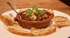 Catalan Meatballs, smoked paprika pork and beef meatballs with Catalan-orange cream, toasted almonds and grilled crostini | Green Valley Grill | Greensboro, NC