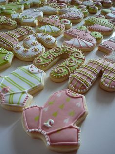 - I made these cookies for new born Justine. These are butter almond cookies covered with Royal Icing. All different design, so sweet and girly!