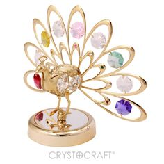 Pavão com cauda aberta banhado a ouro 24K com cristais SWAROVSKI