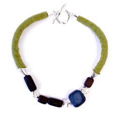 Warmness - Chunky Wooden Beads and Wool Felt Necklace  http://www.balticlabel.com/en/decomundo-en/warmness-chunky-wooden-beads-and-wool-felt-necklace