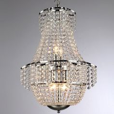 Traditional lines are represented in this two-level chandelier. Crystals gracefully cascade from a smaller diameter chrome-finished frame to a larger circular frame laden with crystal strands.